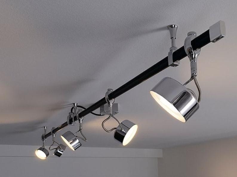 Трековые системы освещения на шинопроводе в интерьере дома